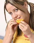 Cute teen eating oranges! from Andi Pink