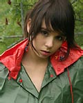 Teen plays under the rain from Ariel Rebel